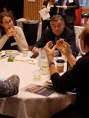 a group pf planners sitting at a round table