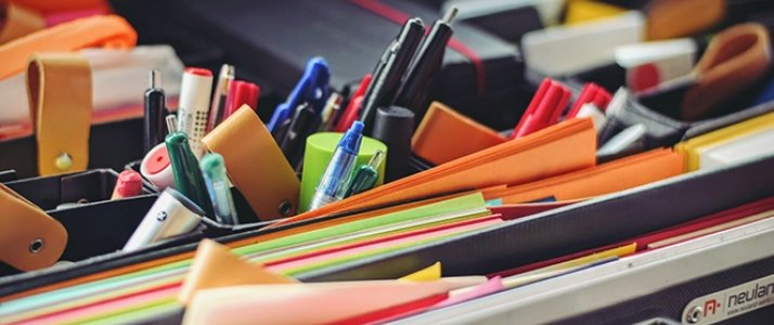 folder with pens and paper