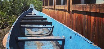 blue canoe on the ground